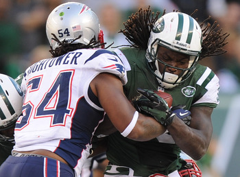 Hi-res-185435176-chris-ivory-of-the-new-york-jets-is-tackled-by-donta_display_image