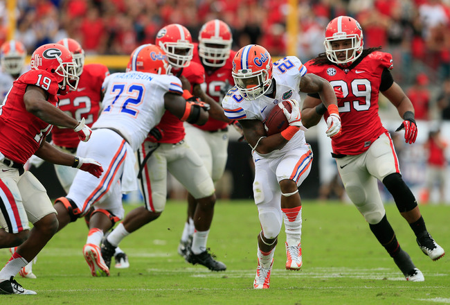 Hi-res-154981809-mike-gillislee-of-the-florida-gators-runs-for-yardage_crop_650x440
