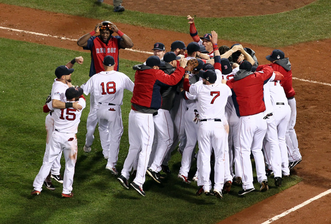 Hi-res-186393077-the-boston-red-sox-celebrate-after-defeating-the-st_crop_650x440