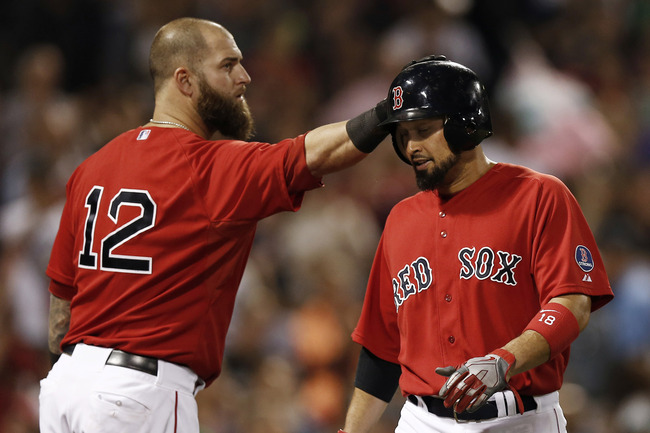 Hi-res-178701145-shane-victorino-of-the-boston-red-sox-is-tapped-on-the_crop_650