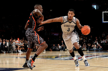 Hi-res-163674939-mikael-hopkins-of-the-georgetown-hoyas-drives-in-the_display_image