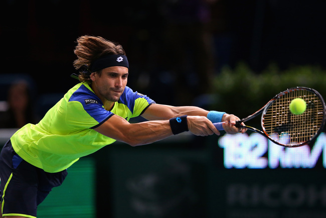 PARIS, FRANCE - OCTOBER 31:  David Ferrer of Spain in action against Gilles Simon of France during day four of the BNP Paribas Masters at Palais Omnisports de Bercy on October 31, 2013 in Paris, France.  (Photo by Julian Finney/Getty Images)