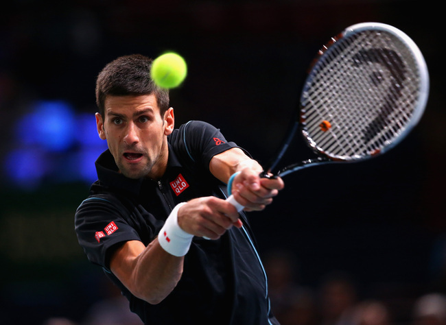 Hi-res-186439116-novak-djokovic-of-serbia-in-action-against-john-isner_crop_650