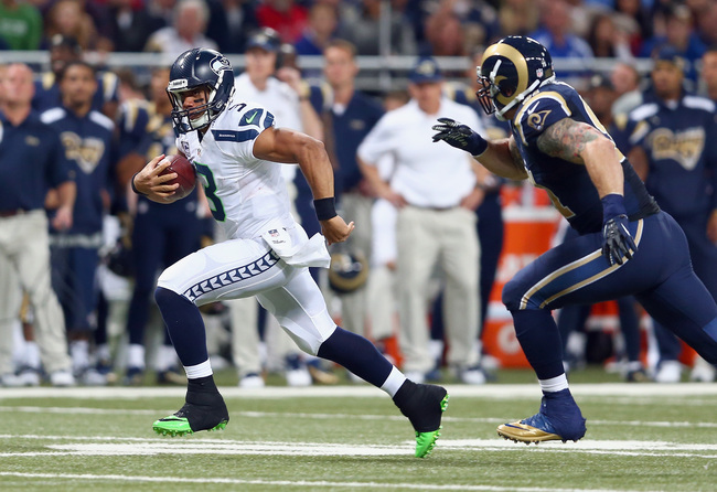 Hi-res-186155410-russell-wilson-of-the-seattle-seahawks-runs-with-the_crop_650