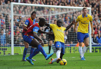 Hi-res-185922859-bacary-sagna-of-arsenal-is-challenged-by-yannick_display_image