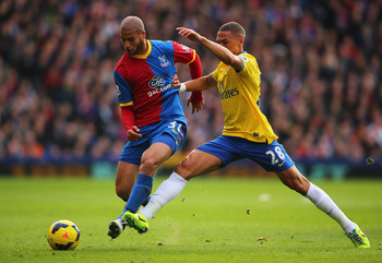 Hi-res-185913915-adlene-guedioura-of-crystal-palace-is-challenged-by_display_image