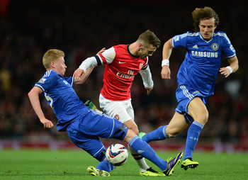 Hi-res-186219610-jack-wilshere-of-arsenal-is-tackled-by-kevin-de-bruyne_display_image