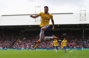 Hi-res-185917243-olivier-giroud-of-arsenal-celebrates-his-goal-during_display_image