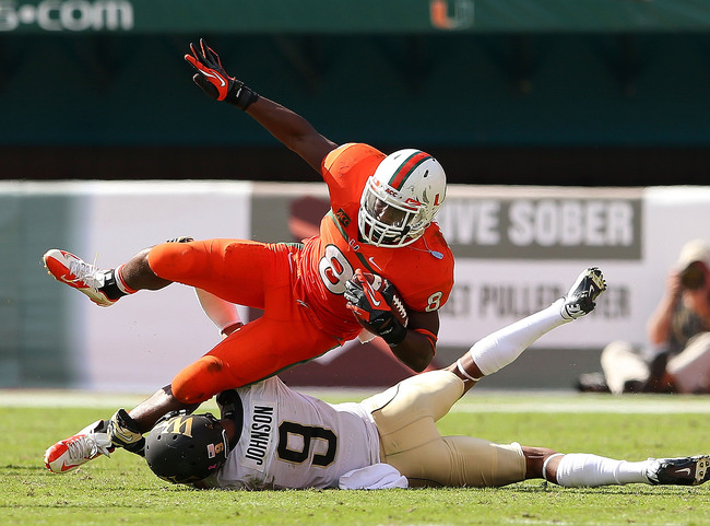 Hi-res-185954240-duke-johnson-of-the-miami-hurricanes-rushes-during-a_crop_650