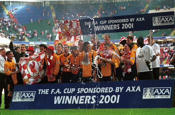 Hi-res-987221-may-2001-liverpool-players-celebrate-after-winning-the-axa_display_image