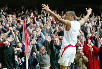 Hi-res-3284451-thierry-henry-of-arsenal-celebrates-scoring-his-hat-trick_display_image
