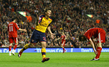 Hi-res-86095080-andrey-arshavin-of-arsenal-celebrates-scoring-his-teams_display_image