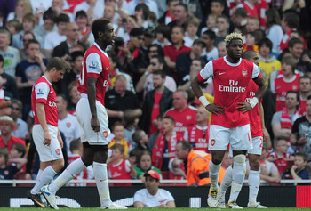 Hi-res-112285650-dejected-andrey-arshavin-johan-djourou-and-alex-song-of_display_image