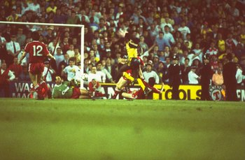 Hi-res-1626446-may-1989-michael-thomas-of-arsenal-defeats-goalkeeper_display_image