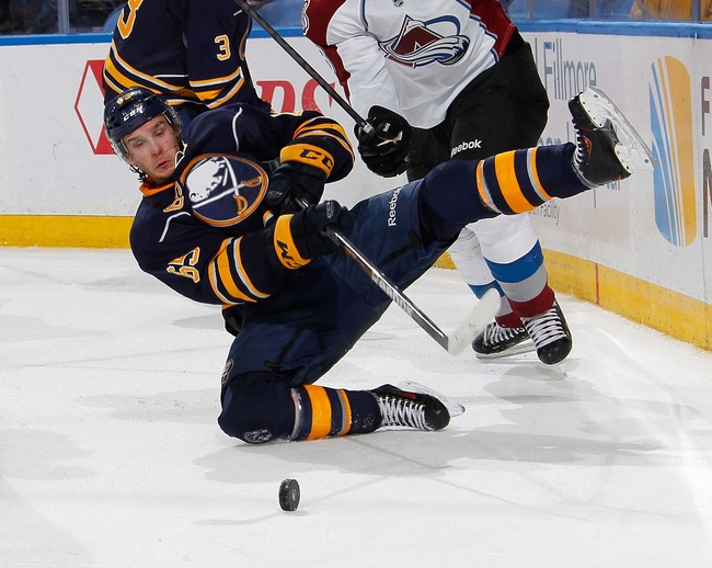 Hi-res-185374197-brian-flynn-of-the-buffalo-sabres-is-upended-by-jan_crop_650