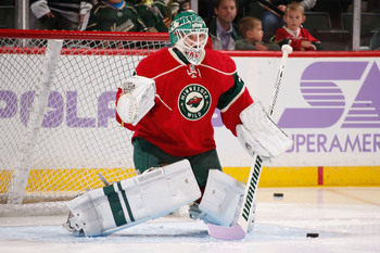 Hi-res-185593170-josh-harding-of-the-minnesota-wild-uses-a-stick-with_display_image