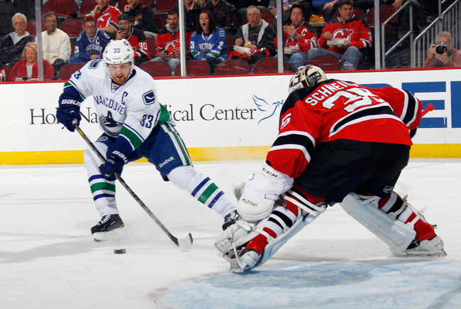 Hi-res-185873229-henrik-sedin-of-the-vancouver-canucks-skates-against_crop_650