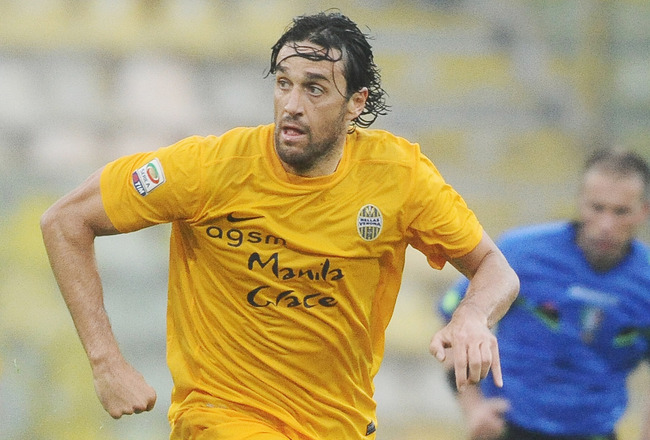Hi-res-183689298-luca-toni-of-hellas-verona-fc-in-action-during-the_crop_650x440