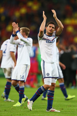 Hi-res-182606981-frank-lampard-of-chelsea-applauds-the-travelling_display_image