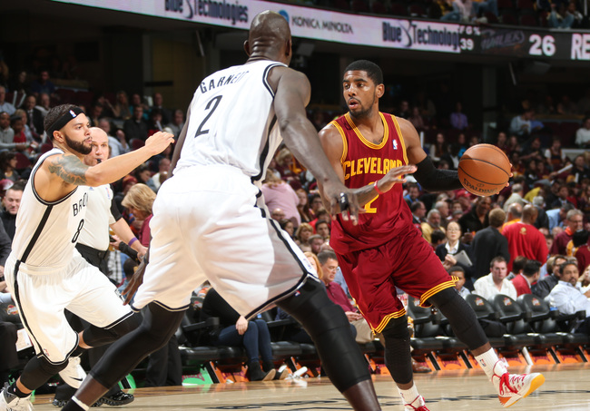 Hi-res-186393072-kyrie-irving-of-the-cleveland-cavaliers-drives-against_crop_650