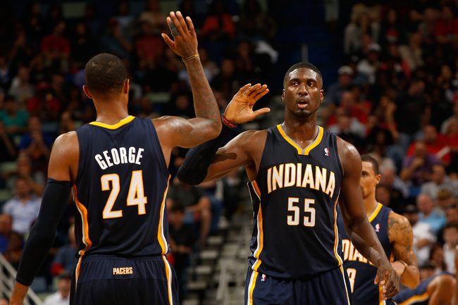 Hi-res-186389782-paul-george-and-roy-hibbert-of-the-indiana-pacers-react_crop_650
