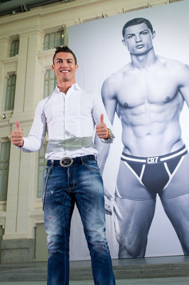 MADRID, SPAIN - OCTOBER 31:  Cristiano Ronaldo poses in front of a 19m high billboard during the global launch of the CR7 by Cristiano Ronaldo Underwear line at the Palacio de Cibeles on October 31, 2013 in Madrid, Spain. CR7 by Cristiano Ronaldo is avail