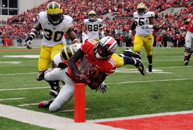 Hi-res-156902363-corey-brown-of-the-ohio-state-buckeyes-scores-a_crop_650x440
