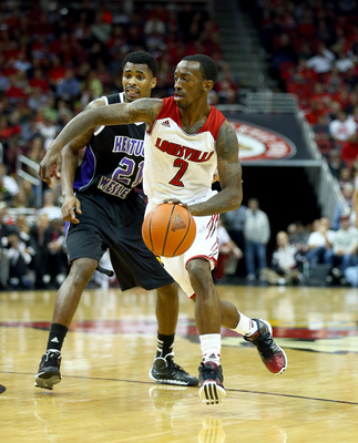 Hi-res-186252378-russ-smith-of-the-louisville-cardinals-dribbles-the_display_image