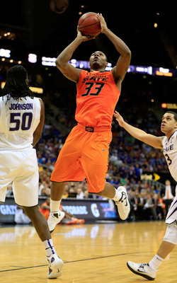 Hi-res-163781538-marcus-smart-of-the-oklahoma-state-cowboys-shoots_display_image