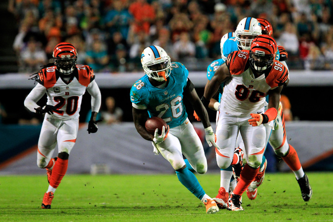 Hi-res-186502846-lamar-miller-of-the-miami-dolphins-runs-with-ball-under_crop_650