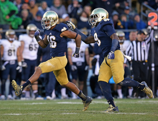 Hi-res-186732922-eilar-hardy-and-jaylon-smith-of-the-notre-dame-fighting_crop_650