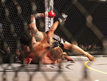 Ferreira (top) ground and pounds Chris Feist at Legacy FC 24.