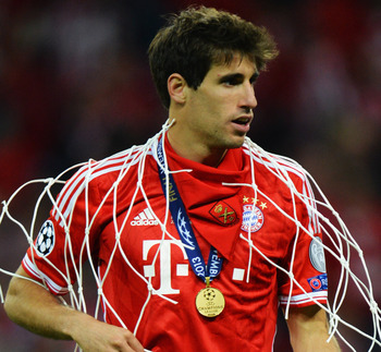 Hi-res-169505192-javi-martinez-of-bayern-muenchen-holds-a-section-of-the_display_image