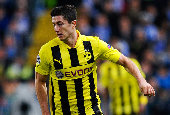 Hi-res-165534760-robert-lewandowski-of-borussia-dortmund-runs-with-the_crop_650x440