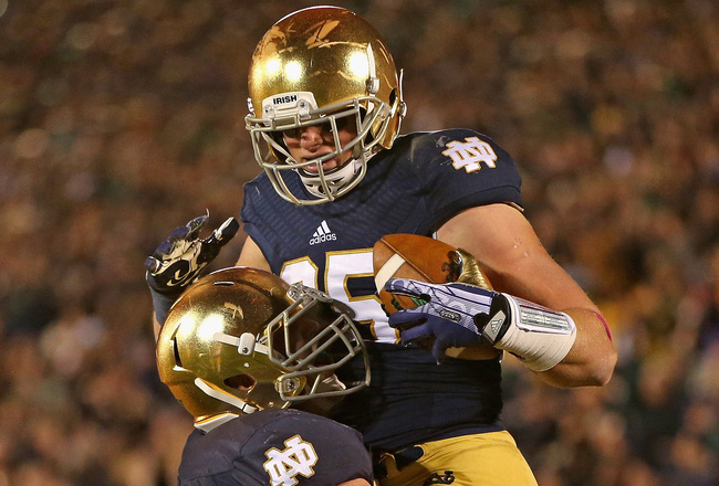 Hi-res-185674496-nick-martin-of-the-notre-dame-fighting-irish-lifts-troy_crop_650x440