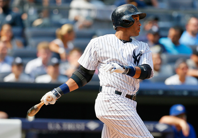 Hi-res-177064811-robinson-cano-of-the-new-york-yankees-hits-a-single-in_crop_650