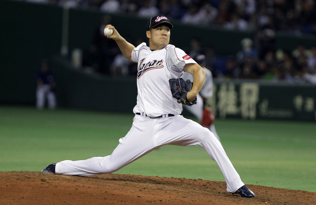 Hi-res-163554376-pitcher-masahiro-tanaka-of-japan-pitches-in-the-fifth_crop_650
