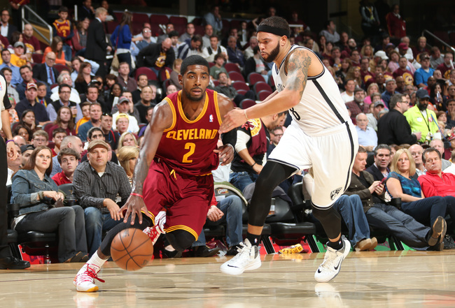 Hi-res-186393075-kyrie-irving-of-the-cleveland-cavaliers-drives-against_crop_650