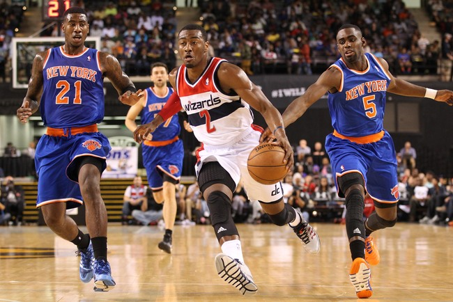 Hi-res-185149275-john-wall-of-the-washington-wizards-drives-against-iman_crop_650