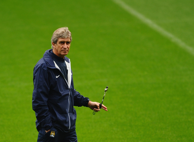 Hi-res-182580143-manuel-pellegrini-of-manchester-city-looks-on-during-a_crop_650