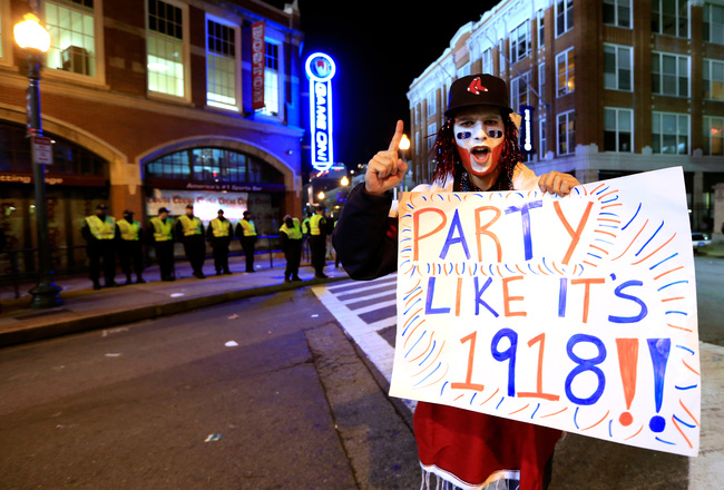 Hi-res-186402720-fan-holds-a-sign-after-the-boston-red-sox-defeated-the_crop_650x440