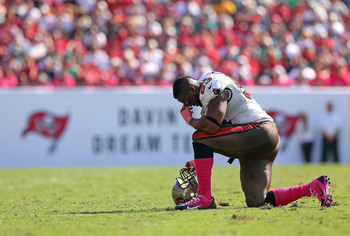 Hi-res-184415883-gerald-mccoy-of-the-tampa-bay-buccaneers-takes-a-knee_display_image