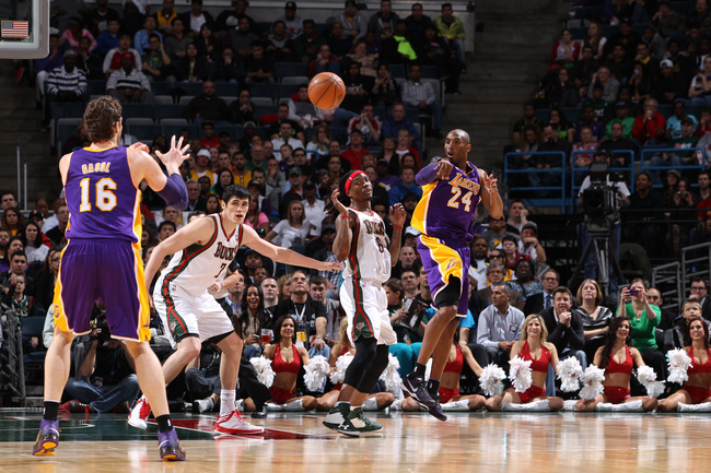 Hi-res-167088216-kobe-bryant-passes-the-ball-to-pau-gasol-of-the-los_crop_650