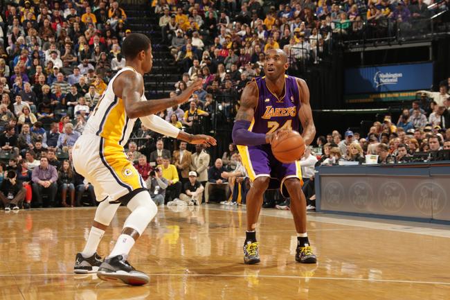 Hi-res-163778747-kobe-bryant-of-the-los-angeles-lakers-looks-to-shoot_crop_650