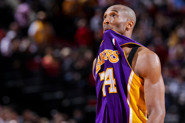Hi-res-166290278-kobe-bryant-of-the-los-angeles-lakers-bites-his-jersey_crop_650