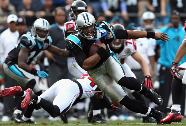 Hi-res-158027703-cam-newton-of-the-carolina-panthers-runs-with-the-ball_crop_650x440