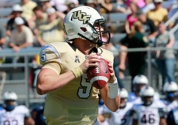 Hi-res-186101806-worton-of-the-ucf-knights-attempts-a-pass-during-the_display_image