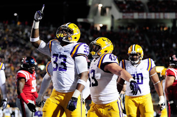 Hi-res-185381439-jeremy-hill-of-the-lsu-tigers-celebrates-a-touchdown_display_image