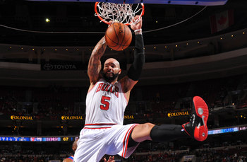 Hi-res-186660569-carlos-boozer-of-the-chicago-bulls-dunks-against-the_display_image