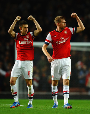 Hi-res-186640004-laurent-koscielny-of-arsenal-and-per-mertesacker-of_display_image